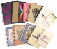 an assortment of custom journals with clear poly covers
