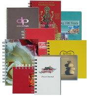 a colorful assortment of custom prayer and retreat journals